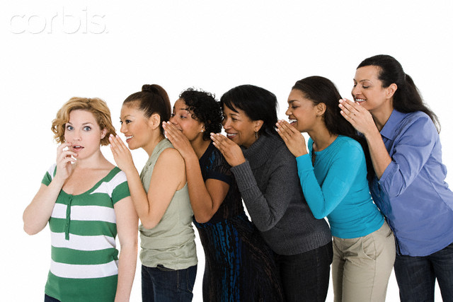 Women whispering --- Image by © Image Source/Corbis