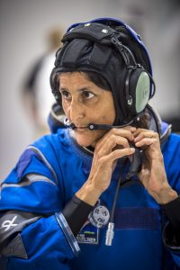 nasa-astronaut-suni-williams-wears-the-usual-snoopy-cap-communications-systems-which-go-under-the-starliners-helmet